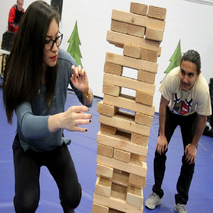 Students playing jenga