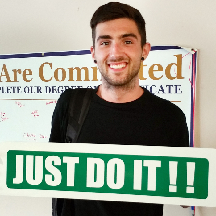 student with just do it sign